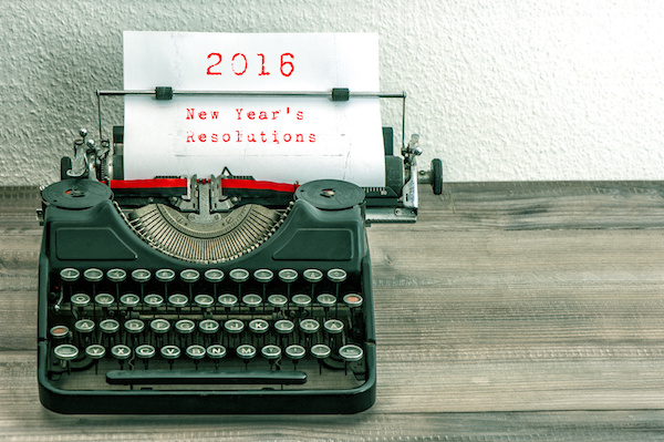 Typewriter with white paper page on wooden table. sample text 2016 New Year's Resolutions. vintage style toned picture